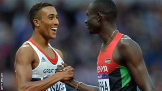 David Rudisha is congratulated by Andrew Osagie