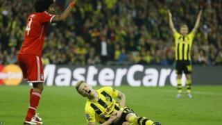 Dante fouls Marco Reus for the penalty from which Dortmund equalise
