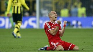 Arjen Robben celebrates scoring the winner for Bayern Munich