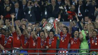 Philipp Lahm of Bayern Munich lifts the Champions League trophy
