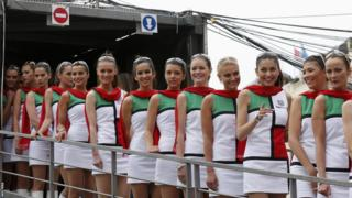 Pit girls line up during the qualifying session of the Monaco