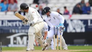 Graeme Swann (out of picture) bowls New Zealand batsman Ross Taylor