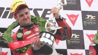 Michael Dunlop celebrates a victory at the Isle of Man TT