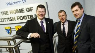 SFA chief executive Stewart Regan, flanked by SPL counterpart Neil Doncaster (left) and the SFL's David Longmuir