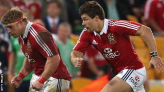 Tom Youngs (L) and his brother Ben Youngs in action for the Lions