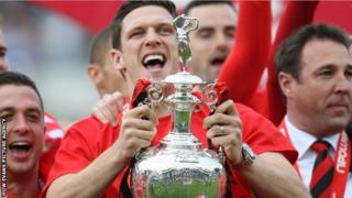 Mark Hudson celebrates Cardiff's promotion to the Premier League
