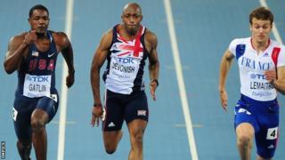 Marlon Devonish races alongside Justin Gatlin (left) and France's Christophe Lemaitre (r)