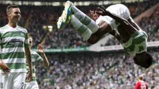Efe Ambrose celebrates his goal with a summersault