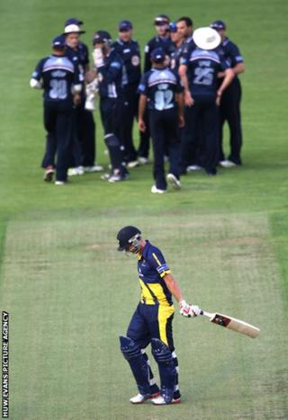 Glamorgan batsman Chris Cooke trudges off as Northants players celebrate his wicket in the FLt20 clash at the Swalec Stadium.