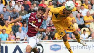 Newport County Christian Jolley heads the ball during his side's final pre-season friendly against Aston Villa at Rodney Parade.
