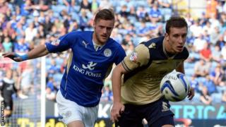 Jamie Vardy of Leicester (left) and Jason Pearce of Leeds