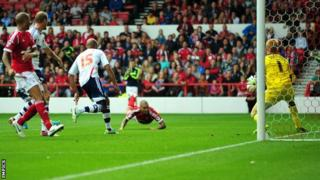 Henri Lansbury heads Nottingham Forest's third goal against Bolton Wanderers
