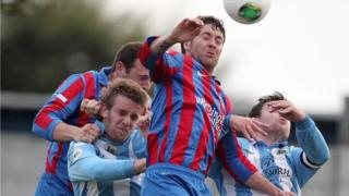 Match action from Ards against Warrenpoint Town