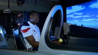 Lutalo Muhammad in a flight simulator