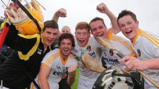 Antrim players celebrate their semi-final win