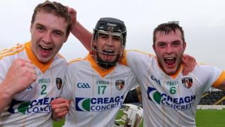 Antrim's Conal Morgan, David Kearney and Paddy McNaughton celebrates after their surprise win over Wexford