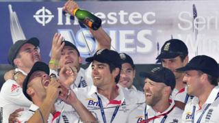 Jonathan Trott, who scored two half-centuries in the series, holds the replica urn as his team-mates look on.