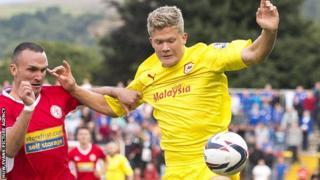 Tom Aldred of Accrington Stanley, left, challenges Andreas Cornelius of Cardiff City