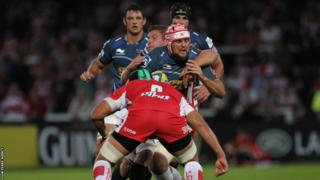 Jo Snyman is stopped by Gloucester's Ben Morgan as the Scarlets lose 31-17 in their pre-season game at Kingsholm