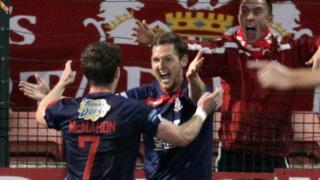 Portadown's Peter McMahon celebrates with goalscorer Gary Twigg