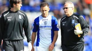 Neal Eardley leaves the pitch after suffering his knee injury against Ipswich