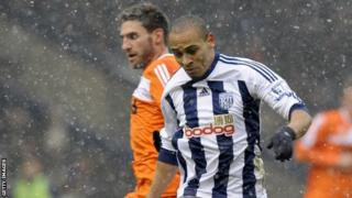 Peter Odemwingie in 2012 action for West Brom against Swansea City