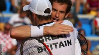 Andy Murray hugs Colin Fleming