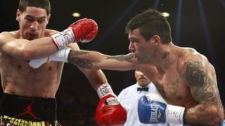 Lucas Matthysse lands a blow on Danny Garcia