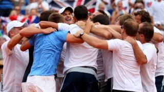 Andy Murray is mobbed by the Great Britain team