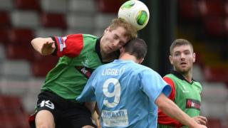 Match action from Glentoran against Ballymena United at The Oval