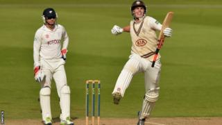 Dominic Sibley (right) celebrates reaching his hundred