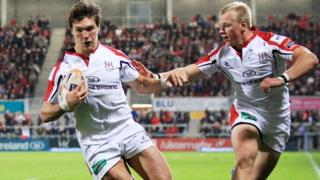 Michael Allen scores a try for Ulster supported by Luke Marshall