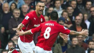Steven Caulker celebrates with Gary Medel as his first goal for Cardiff gives them the lead in their Premier League game at Fulham