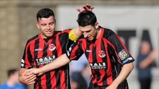 Colin Coates and Paul Leeman celebrate Crusaders' second goal against Glenavon