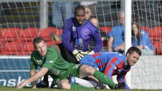 Goalmouth action from Ards' 4-1 win over Ballinamllard at Dixon Park
