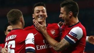 Mesut Ozil celebrates Arsenal's first goal