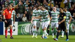 Referee Stephane Lannoy orders Celtic captain Scott Brown off against Barcelona