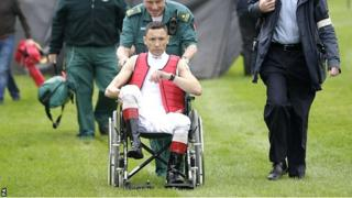 Frankie Dettori is wheeled away following his fall at Nottingham