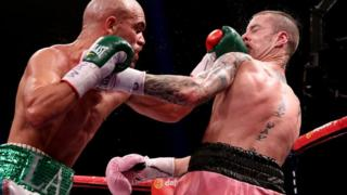 Ricky Burns is caught by a punch from Raymundo Beltran