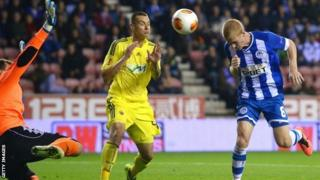 Wigan Athletic's Ben Watson (right) heads the second goal during the Uefa Europa League Group D match v Maribor