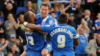 Tyrone Barnett (left) celebrates with team-mates