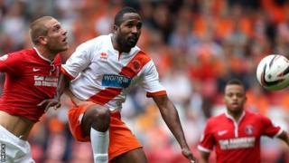 Blackpool's Ricardo Fuller (centre) in action against Charlton
