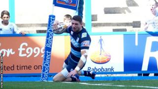 Wing Alex Cuthbert scores a try for the Cardiff Blues