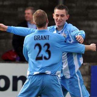 Timmy Grant congratulates Daniel Hughes who scored Warrenpoint's first goal in their 2-2 draw with Portadown
