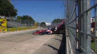 Dario Franchitti collides with Takuma Sato on the last lap of the IndyCar race in Houston