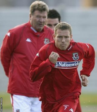 Bellamy trains under the watchful eye of Wales manager John Toshack