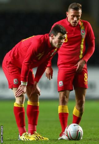Gareth Bale and Bellamy line up a free-kick during the friendly international against Austria at Swansea's Liberty Stadium in February 2013