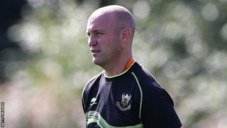 Alex King observes Saints training