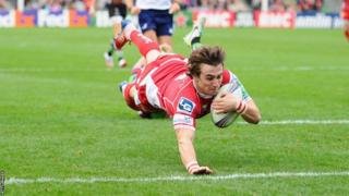 Scrum-half Rhodri Williams goes over for the Scarlets in the Heineken Cup at Harlequins