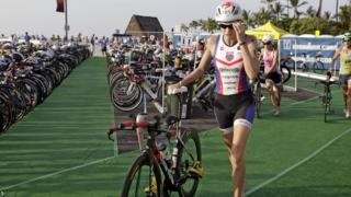 Defending Ironman World Championship Triathlon title-holder Leanda Cave finishes 13th in the 2013 event in Hawaii